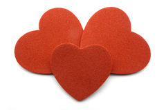 Three red hearts. At white background stock photos