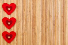 Three red Hearts on a wooden background, a card fort Valentine`s day. With some free space for your text or sign. Valentines day Stock Photography