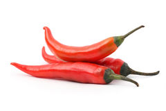 Three Red Hot Chile Peppers. Pile of red hot chili peppers isolated on white background Royalty Free Stock Photo