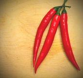 Three red hot chili peppers Royalty Free Stock Photography