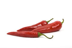 Three red hot peppers Stock Photo