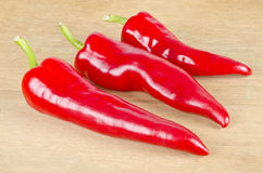 Three Red Hot Peppers. Of varying sizes Stock Image