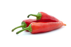 Three red hot peppers Stock Photos