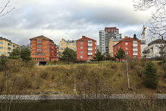 Three red houses on the river Bank in Stockholm, Sweden Stock Images