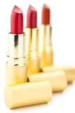 Three red lipsticks Royalty Free Stock Photo