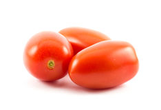 Three red long tomatoes on a white background.  royalty free stock image