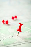 Three Red Marking Pins on Top of a Map Royalty Free Stock Photos