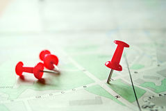 Three Red Marking Pins on Top of a Map Royalty Free Stock Images
