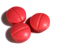 Three red medicine pills Royalty Free Stock Photos