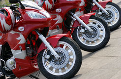 Three red motorcycles. The front wheels of three red motorcycles are placed in a row Stock Photos