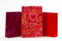 Three red packet with hearts on a white background.  stock images