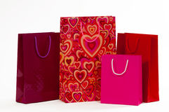 Three red packet with hearts on a white background.  stock photo
