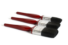 Three red paint brushes Royalty Free Stock Photography