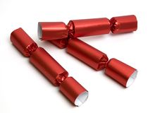 Three red party crackers Royalty Free Stock Photo