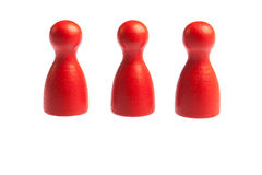 Three red pawn game figures Stock Photo