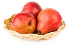 Three red pear in basket Royalty Free Stock Image