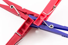 Three Red Pegs Attacking Blue Peg Royalty Free Stock Image