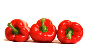 Three red peppers Stock Images