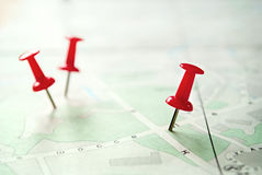 Three Red Pins Pinned on Green White Map. Conceptual Three Sharp Red Pins Pinned on Green White Map for Markings, Captured in Close up royalty free stock photo