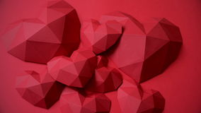 Three red polygonal paper heart shape over wooden bachground stock footage