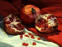 Three Red Pomegranates. Pomegranate red orange blue food tasty sphere granat Royalty Free Stock Image