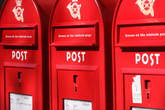 Three red post boxes Royalty Free Stock Photography