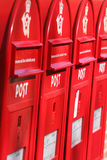 Three red post boxes Stock Image