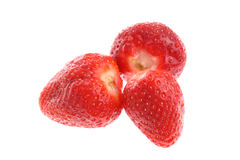 Three red ripe strawberries isolated on white Stock Photo