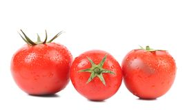 Three red ripe tomatoe. Stock Images