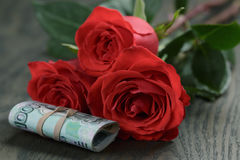 Three red roses and bunch of russian money Royalty Free Stock Image