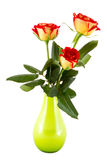 Three red roses in a green vase. A three red roses in a green vase Stock Photography