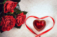 Three red roses and heart Royalty Free Stock Image