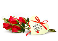 Three red roses with a heart-shaped Happy Mother's Day note Royalty Free Stock Photo