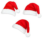 Three red santa hats.  Stock Photo