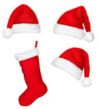 Three red santa hats and christmas stocking. Royalty Free Stock Images