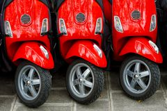 Three red scooters stock photos