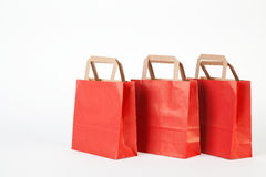 Three red shopping bag. Stock Photos