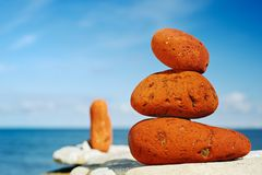 Three red stones. On a beach in the morning in the summer Royalty Free Stock Photos