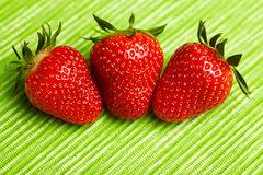 Three red strawberries Royalty Free Stock Images