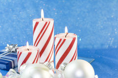 Three red striped Christmas candles Stock Photos