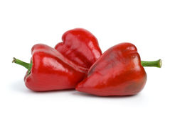 Three red sweet peppers. Isolated on the white background Royalty Free Stock Image