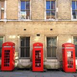 Three Red Telephone Boxes Stock Photography