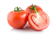 Three red tomatoes Stock Images