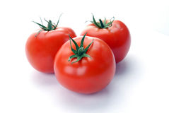 Three red tomatoes Stock Image