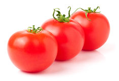 Three red tomatoes on white background Stock Photography
