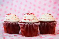 Three red velvet cupcakes Stock Image