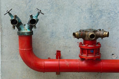 Three red water valves Royalty Free Stock Photos