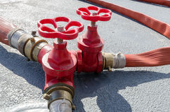 Three red water valves Stock Photography