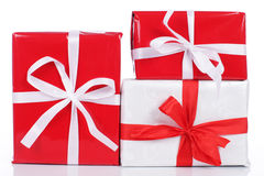 Three red and white gift boxes Stock Photos
