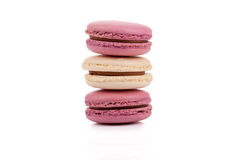 Three red and white stacked macaroons isolated Stock Image